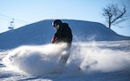 FILE-A snowboarder at Spirit Mountain in 2019. Duluth's public ski hill is expected to report a profit from this season and plans to invest heavily