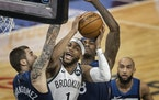 Brooklyn Nets forward Bruce Brown (1) drove to the basket  on Minnesota Timberwolves forward Juancho Hernangomez (41) and forward Jarred Vanderbilt (8