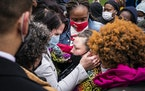 Katie Wright, center, the mother of Daunte Wright, was embraced by George Floyd's girlfriend Courtney Ross, left,before a news conference outside th