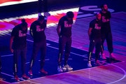 """Members of the Timberwolves and the Brooklyn Nets wear T-shirts that read """"With liberty and justice for all"""" as a tribute to Daunte Wright, before"""
