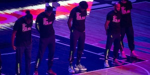 "Members of the Timberwolves and the Brooklyn Nets wear T-shirts that read ""With liberty and justice for all"" as a tribute to Daunte Wright, before"