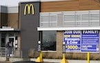 FILE - In this Nov. 19, 2020, file photo, a hiring sign is displayed outside of McDonald's in Buffalo Grove, Ill.
