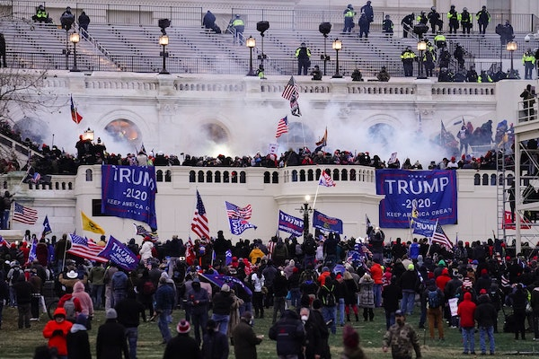 FILE - In this Jan. 6. 2021, file photo, people storm the Capitol in Washington. A blistering internal report by the U.S. Capitol Police describes a m