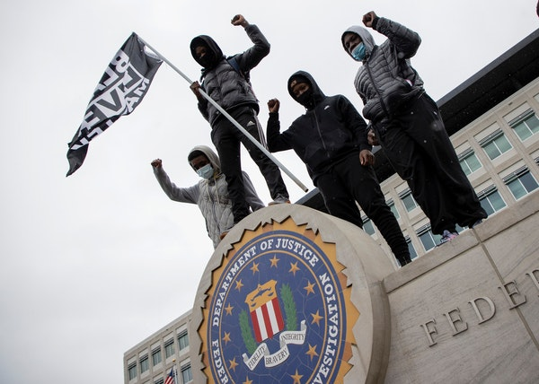 Protesters posed for photos at an FBI Building in Brooklyn Center during a rally in response to the death of Daunte Wright, Tuesday, April 13, 2021 in