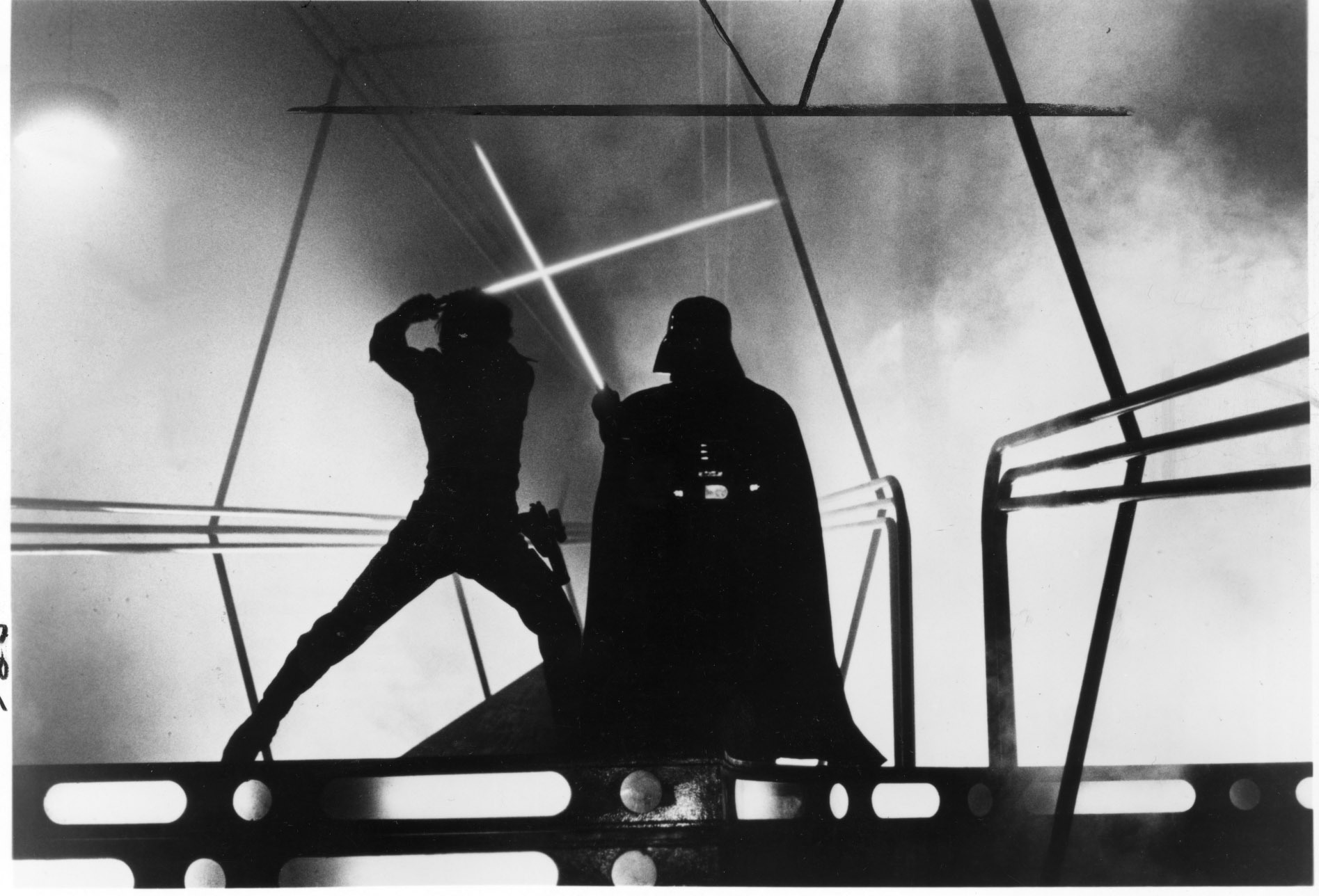 Luke Skywalker (played by Mark Hamill, at left) battles Darth Vader (played by David Prowse, right).