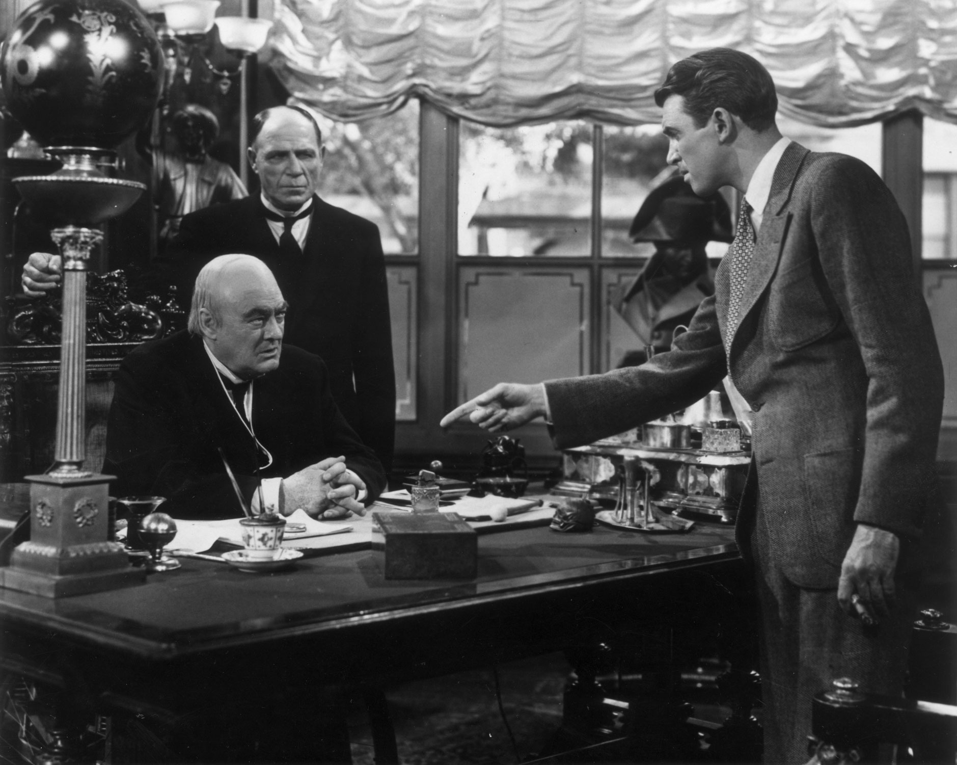 'It's a Wonderful Life' stars James Stewart, right, in this scene with Lionel Barrymore,seated at desk.