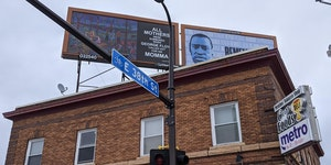 Billboards designed by Jim Denomie and Seitu Jones rise above the corner where George Floyd was killed. Across the street is another, by Xavier Tavera