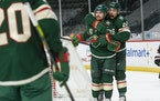 Mats Zuccarello and Matt Dumba, right, celebrated after Zuccarello scored his first goal for the Wild on Wednesday.