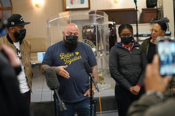 Brian Ingram of One Restaurant Group, second from left, gets emotional while presenting a check for $17,000 to Chyna Whitaker, second from right, the