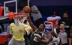 Milwaukee Bucks forward Mamadi Diakite (25) pushed away the arm of Minnesota Timberwolves forward Jarred Vanderbilt (8) while trying to dunk in the fo