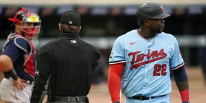 Minnesota Twins first baseman Miguel Sano (22) looked back after getting out on a pop fly to Boston Red Sox first baseman Bobby Dalbec (23) in the sec