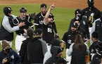 Chicago White Sox starting pitcher Carlos Rodon (55) celebrates his no hitter against the Cleveland Indians with his teammates Wednesday in Chicago.