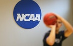 The NCAA Division I Council voted Wednesday to changed the long-standing rule that has often deterred players in high-profile sports from switching sc