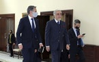 Abdullah Abdullah, Chairman of the High Council for National Reconciliation, center, walks with U.S. Secretary of State Antony Blinken, at the Sapidar