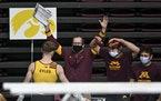 Gophers men's gymnastics coach Mike Burns celebrated a clean dismount by Ben Eyles off the high bar during a meet against Iowa in January. Both the