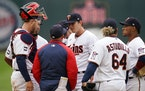 Minnesota Twins relief pitcher Brandon Waddell (58) talked with Minnesota Twins pitching coach Wes Johnson (47) as he visited the mound in the sixth i