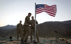 A new American flag was raised at Forward Operating Base Bostick in Kunar province, Afghanistan, on Sept. 11, 2011, to commemorate the tenth anniversa
