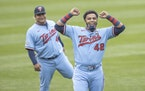 Minnesota Twins players including Nelson Cruz, right, and Willians Astudillo, left, wore the #42 to honor Jackie Robinson Day, Thursday, April 15, 202