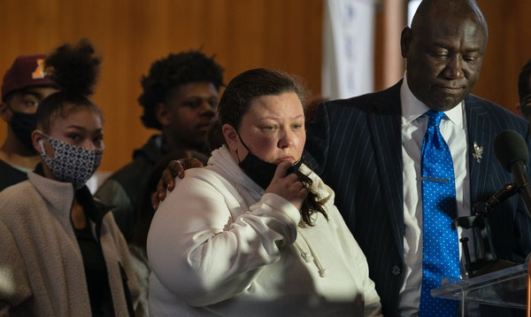 Katie Wright, the mother of Daunte Wright, was consoled by attorney Ben Crump during a news conference in Minneapolis.
