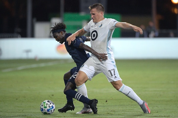 Robin Lod, right, and the Loons face Sporting KC three times, including Aug. 21 for Rivalry Week.