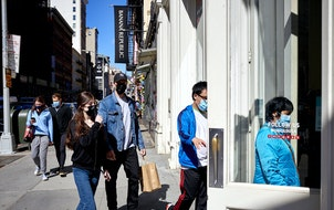 Shoppers entered a Uniqlo store in lower Manhattan on April 13, 2021. Retail sailes surged in March.