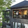 Architect Ali Awad designed this lake home for his family in Burnsville. The three-level home includes a room with a garage door that opens to the lak