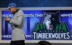 Karl-Anthony Towns walks off stage after being selected first overall by the Wolves in 2015.