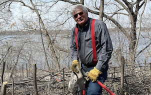 """Jim Nicholas of Minneapolis is a familiar presence around Lake Harriet as he battles buckthorn, """"the poster child for invasive species."""""""