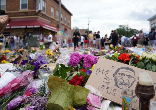 A sketch of George Floyd laid among flowers and candles at the site of his death near Cup Foods in south Minneapolis in June 2020.