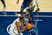 Timberwolves forward Josh Okogie defends against Brooklyn forward Kevin Durantduring the second half on April 13.