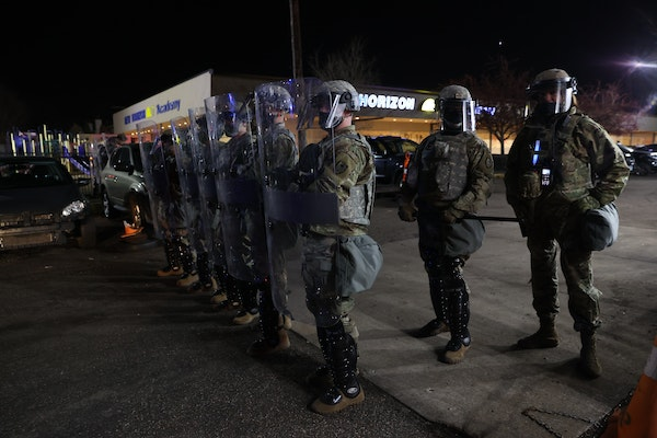 Law enforcement lined up in a shopping center parking lot on Humboldt Avenue N. after things turned tense during a sixth night of protests outside the