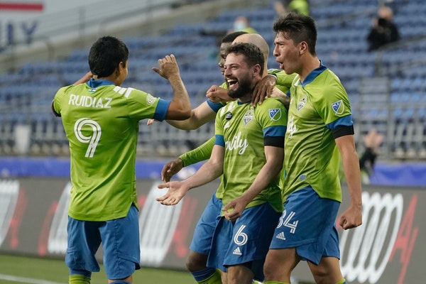 Seattle Sounders midfielder Joao Paulo (6) celebrates with forward Raul Ruidiaz (9) and midfielder Josh Atencio, right, after Paulo scored a goal agai