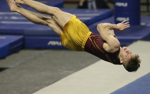 Minnesota's Shane Wiskus competes in the floor exercise during the NCAA men's gymnastics championships Friday
