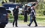 Law enforcement personnel work at the scene following a police involved shooting of a man at Lents Park, Friday, April 16, 2021, in Portland, Ore.