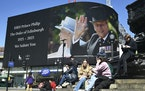 Images of Britain's Prince Philip are displayed on a giant screen at Piccadilly Circus, London Saturday, April 17, 2021.