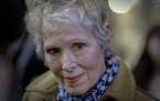 E. Jean Carroll talks to reporters outside a courthouse in New York in March 2020.