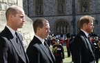 Prince William, Peter Phillips and Prince Harry walk in a procession behind the coffin of Prince Philip, during the funeral of Britain's Prince Phil