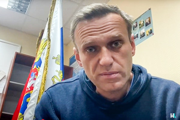 In this image taken from video, Russian opposition leader Alexei Navalny speaks as he waits for a court hearing in a police station in Khimki, outside