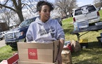 Rachel Nelson, with Twin Cities Relief, hauled a few boxes of food which would be served to community members at a barbecue outside the Kenyan Communi