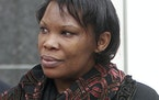 In this April 12, 2012. photo Beatrice Munyenyezi leaves the Federal Court in Concord, N.H. Munyenyezi, who served a 10-year sentence in federal priso