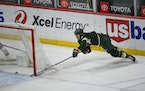Wild center Nico Sturm makes a wraparound shot for goal against the San Jose Sharks during the second period