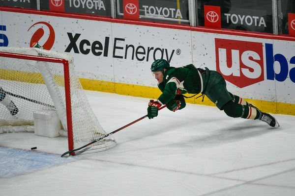 Wild center Nico Sturmmakes a wraparound shot for goal against the San Jose Sharks during the second period