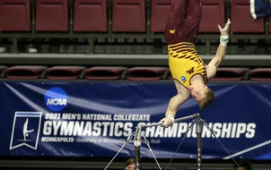 Minnesota's Shane Wiskus competes on the high bar during the NCAA men's gymnastics championships Saturday