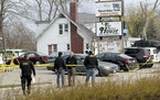 Officials investigate the scene of a deadly shooting at Somers House Tavern in Kenosha, Wis., Sunday, April 18, 2021.