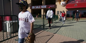 Fans leave Angel Stadium when a baseball game between the Minnesota Twins and the Los Angeles Angels was postponed Saturday, April 17, 2021, in Anahei