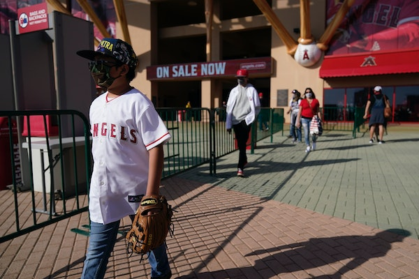 Fans left Angel Stadium when the game between the Twins and Los Angeles Angels was postponed Saturday. Sunday and Monday's games were also postponed
