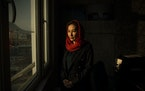"""All the time, women are the victims of men's wars,"" says Raihana Azad, a member of Afghanistan's parliament.  Women watch nervously as the U."