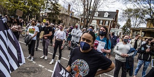 Protesters attended a rally in front of the governor's residence in St. Paul and proceeded to march in the neighborhood to bring attention to Daunte