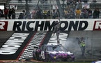 Alex Bowman stood on his car as he celebrated winning a NASCAR Cup Series race at Richmond International Raceway in Richmond, Va., on Sunday.