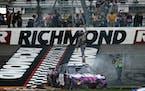 Alex Bowman stood on his car as he celebrated winning a NASCAR Cup Series race at Richmond International Raceway in Richmond, Va., on Sunday.